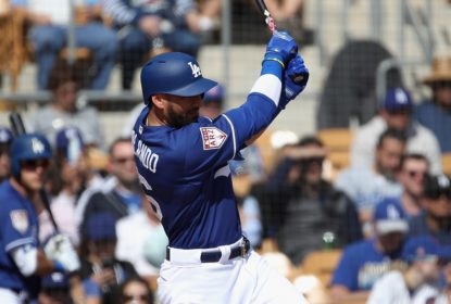 GLENDALE, ARIZONA - FEBRUARY 25: Paulo Orlando #16 of the Los Angeles Dodgers hits a sacrifice fly during the third inning of the MLB spring training game against the Chicago Cubs at Camelback Ranch on February 25, 2019 in Glendale, Arizona