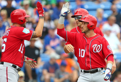PORT ST. LUCIE, FL - MARCH 15: Yan Gomes #10 of the Washington Nationals celebrates his home run with Matt Adams #15 and Ryan Zimmerman #11 against the New York Mets during a spring training baseball game at First Data Field on March 15, 2019 in Port St. Lucie, Florida. The Nationals defeated the Mets 11-3