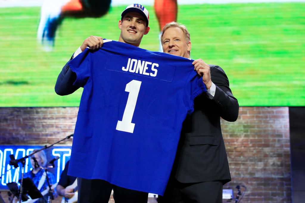 NASHVILLE, TENNESSEE - APRIL 25: Daniel Jones of Duke poses with NFL Commissioner Roger Goodell after being chosen #6 overall by the New York Giants during the first round of the 2019 NFL Draft on April 25, 2019 in Nashville, Tennessee.
