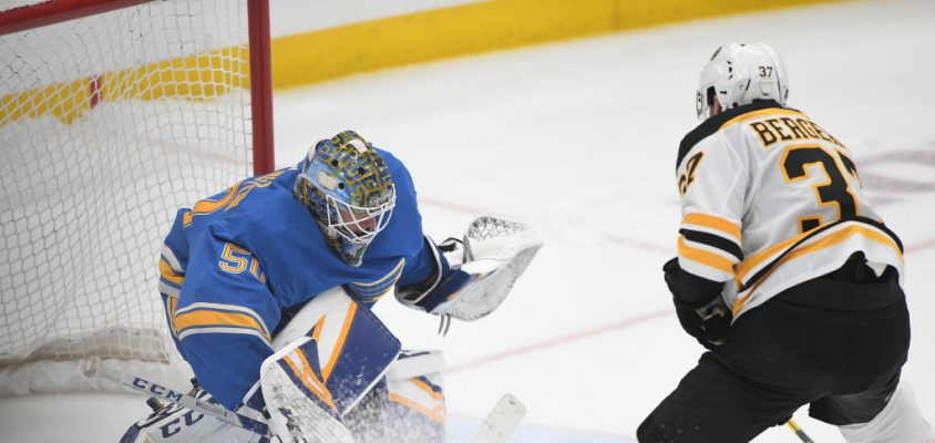 ST. LOUIS, MO- FEBRUARY 23: St. Louis Blues goalie Jordan Binnington (50) blocks an overtime shootout shot by Boston Bruins center Patrice Bergeron (37) during a NHL game between the Boston Bruins and the St. Louis Blues on February 23, 2019, at Enterprise Center, St. Louis, MO.