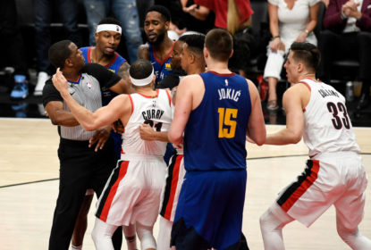 PORTLAND, OR - MAY 9: Seth Curry (31) of the Portland Trail Blazers and Will Barton (5) of the Denver Nuggets are separated as they jaw violently as Torrey Craig (3), Nikola Jokic (15), Zach Collins (33) and CJ McCollum (3) enter the scuffle during the fourth quarter of the Trail Blazers' 119-108 win on Thursday, May 9, 2019. The Portland Trail Blazers tied the series with the Denver Nuggets 3-3 with a game-six win in the teams' second round NBA playoff series at the Moda Center in Portland
