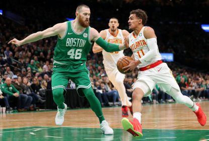 BOSTON, MASSACHUSETTS - MARCH 16: Aron Baynes #46 of the Boston Celtics defends Trae Young #11 of the Atlanta Hawks during the first quarter at TD Garden on March 16, 2019 in Boston, Massachusetts