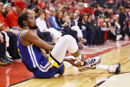 TORONTO, ONTARIO - JUNE 10: Kevin Durant #35 of the Golden State Warriors reacts after sustaining an injury during the second quarter against the Toronto Raptors during Game Five of the 2019 NBA Finals at Scotiabank Arena on June 10, 2019 in Toronto, Canada.