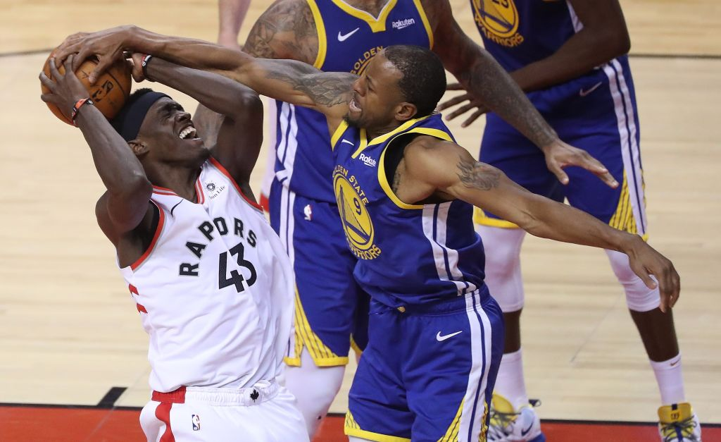 TORONTO, ON- JUNE 2: Golden State Warriors guard Andre Iguodala (9) forces a jump ball with Toronto Raptors forward Pascal Siakam (43) as the Toronto Raptors play the Golden State Warriors in game Two of the NBA Finals at Scotiabank Arena in Toronto.