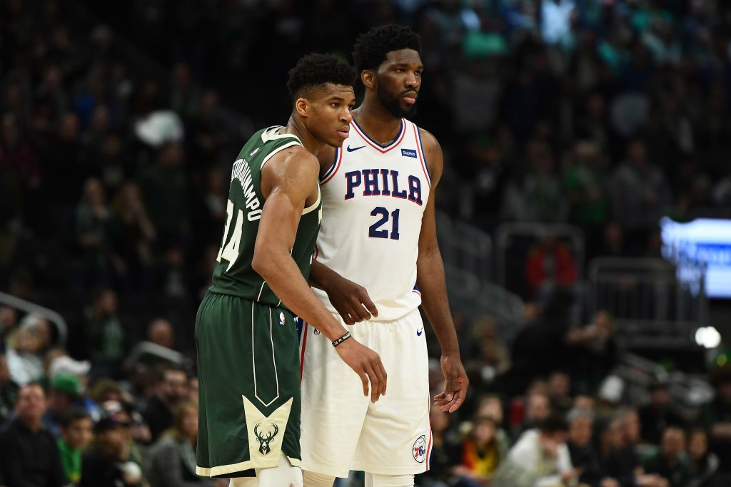 MILWAUKEE, WISCONSIN - MARCH 17: Giannis Antetokounmpo #34 of the Milwaukee Bucks works against Joel Embiid #21 of the Philadelphia 76ers during a game at Fiserv Forum on March 17, 2019 in Milwaukee, Wisconsin