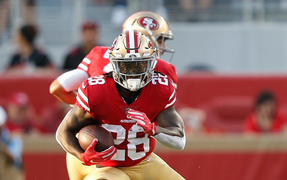SANTA CLARA, CA - AUGUST 9: Jerick McKinnon #28 of the San Francisco 49ers rushes during the game against the Dallas Cowboys at Levi Stadium on August 9, 2018 in Santa Clara, California. The 49ers defeated the Cowboys 24-21