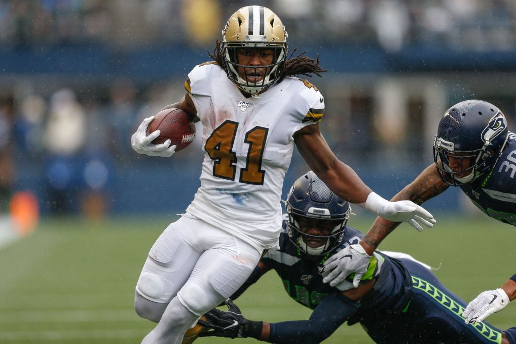 SEATTLE, WA - SEPTEMBER 22: Running back Alvin Kamara #41 of the New Orleans Saints rushes for a touchdown in the second quarter against the Seattle Seahawks at CenturyLink Field on September 22, 2019 in Seattle, Washington
