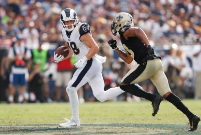 LOS ANGELES, CALIFORNIA - SEPTEMBER 15: Cooper Kupp #18 of the Los Angeles Rams runs on a 67-yard reception during the fourth quarter as Marshon Lattimore #23 of the New Orleans Saints attempts to tackle him in the game at Los Angeles Memorial Coliseum on September 15, 2019 in Los Angeles, California