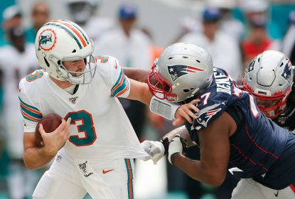 MIAMI, FLORIDA - SEPTEMBER 15: Josh Rosen #3 of the Miami Dolphins is sacked by Michael Bennett #77 of the New England Patriots during the fourth quarter at Hard Rock Stadium on September 15, 2019 in Miami, Florida