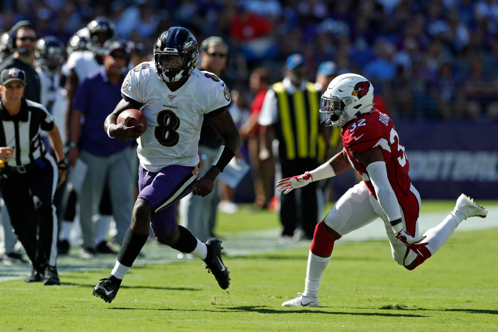 BALTIMORE, MARYLAND - SEPTEMBER 15: Quarterback Lamar Jackson #8 of the Baltimore Ravens runs with the ball against the Arizona Cardinals during the second half at M&T Bank Stadium on September 15, 2019 in Baltimore, Maryland