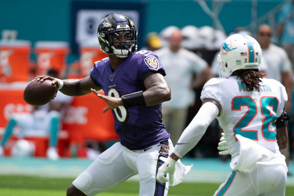 MIAMI GARDENS, FL - SEPTEMBER 08: Baltimore Ravens quarterback Lamar Jackson (8) throws the ball under pressure from Miami Dolphins cornerback Bobby McCain (28) during the NFL game between the Baltimore Ravens and the Miami Dolphins at the Hard Rock Stadium in Miami Gardens, Florida on September 8, 2019