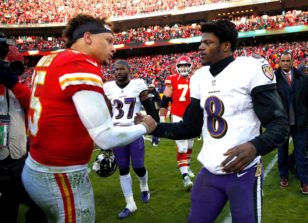 KANSAS CITY, MISSOURI - DECEMBER 09: Quarterback Patrick Mahomes #15 of the Kansas City Chiefs shakes hands with quarterback Lamar Jackson #8 of the Baltimore Ravens after the Chiefs defeated the Ravens 27-24 in overtime to win the game at Arrowhead Stadium on December 09, 2018 in Kansas City, Missouri