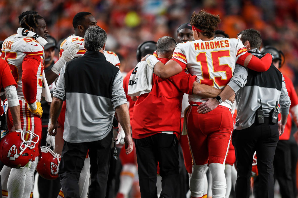 DENVER, CO - OCTOBER 17: Patrick Mahomes #15 of the Kansas City Chiefs is helped off the field after sustaining an injury in the second quarter of a game against the Denver Broncos at Empower Field at Mile High on October 17, 2019 in Denver, Colorado
