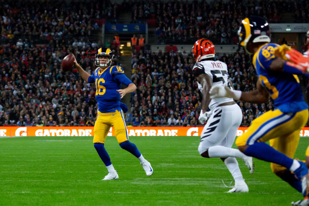 LONDON, ENG - OCTOBER 27: Los Angeles Rams Quarterback Jared Goff (16) runs wide to throw for an incompletion Cincinnati Bengals Safety Jessie Bates III (30) stretches for the ball in his own end zone during the NFL game between the Cincinnati Bengals and the Los Angeles Rams on October 27, 2019 at Wembley Stadium, London, England