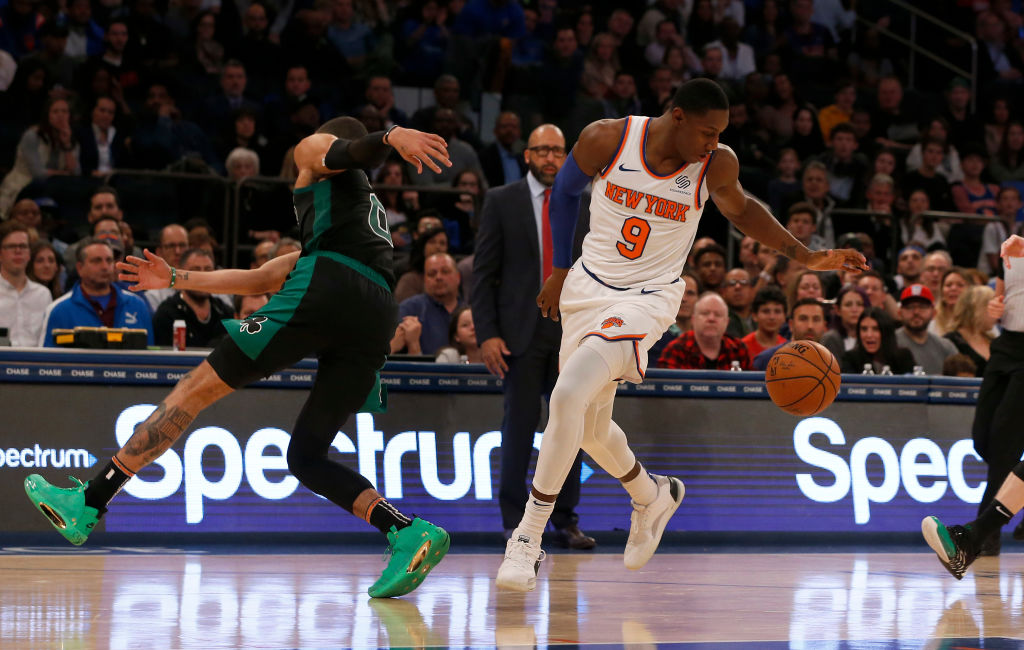 NEW YORK, NEW YORK - OCTOBER 26: (NEW YORK DAILIES OUT) RJ Barrett #9 of the New York Knicks in action against Jayson Tatum #0 of the Boston Celtics at Madison Square Garden on October 26, 2019 in New York City. The Celtics defeated the Knicks 118-95