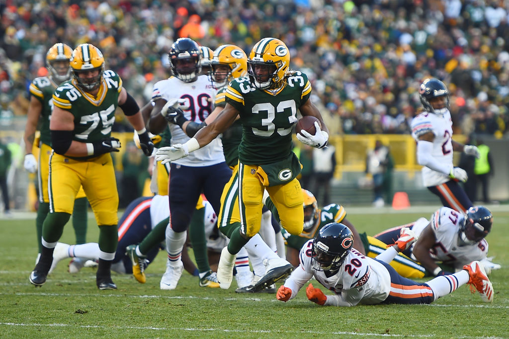 GREEN BAY, WISCONSIN - DECEMBER 15: Aaron Jones #33 of the Green Bay Packers runs for yards during a game against the Chicago Bears at Lambeau Field on December 15, 2019 in Green Bay, Wisconsin