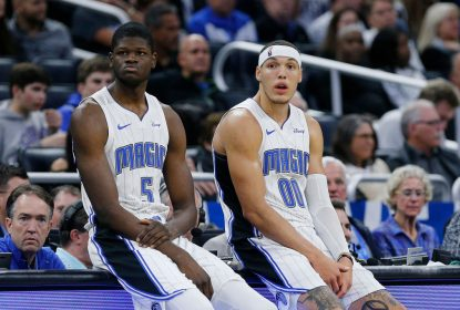 ORLANDO, FLORIDA - DECEMBER 04: Mo Bamba #5 and Aaron Gordon #00 of the Orlando Magic wait to check in against the Phoenix Suns during the second half at Amway Center on December 04, 2019 in Orlando, Florida