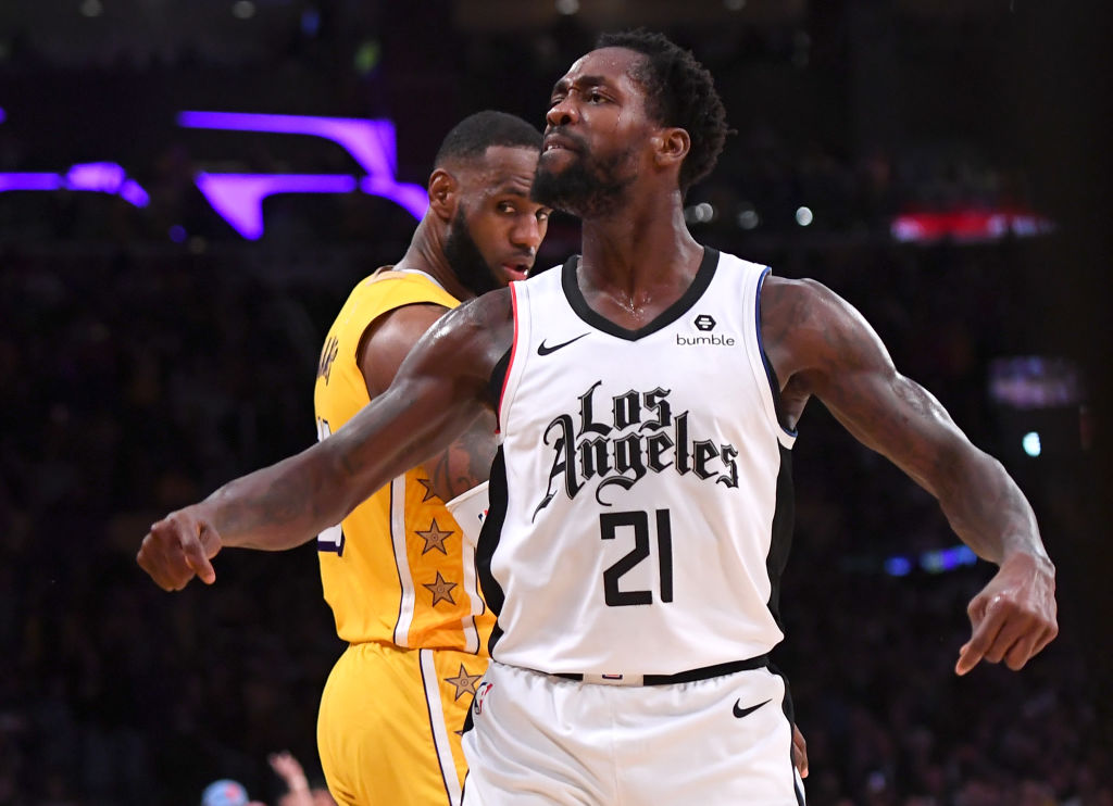 LOS ANGELES, CA - DECEMBER 25: Patrick Beverley #21 of the Los Angeles Clippers looks at the crowd after he blocked a shot by LeBron James #23 of the Los Angeles Lakers in the second half of the game at Staples Center on December 25, 2019 in Los Angeles, California