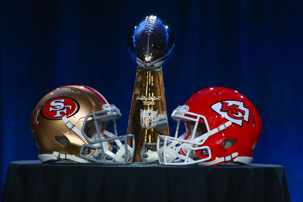 MIAMI, FL - JANUARY 29: The Vince Lombardi Trophy is displayed before the Commissioners press conference with a San Francisco 49ers and Kansas City Chiefs helmet onn January 29, 2020 at the Hilton Downtown in Miami, FL
