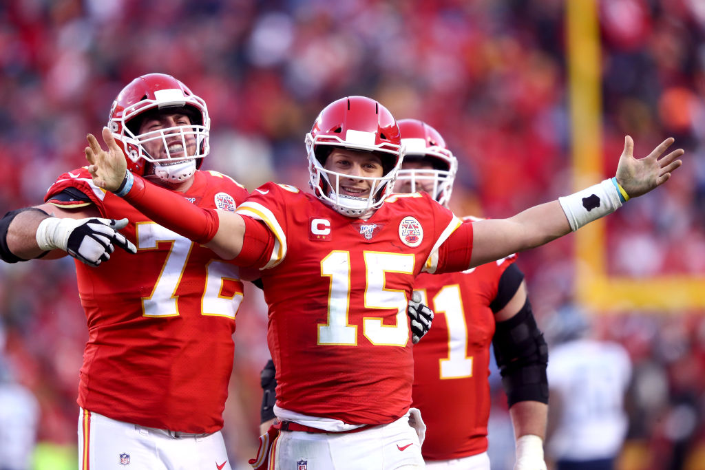KANSAS CITY, MISSOURI - JANUARY 19: Patrick Mahomes #15 of the Kansas City Chiefs reacts with teammates Eric Fisher #72 and Mitchell Schwartz #71 after a fourth quarter touchdown pass against the Tennessee Titans in the AFC Championship Game at Arrowhead Stadium on January 19, 2020 in Kansas City, Missouri