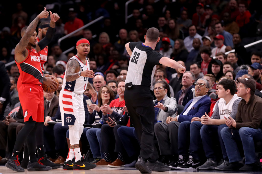 WASHINGTON, DC - JANUARY 03: Isaiah Thomas #4 of the Washington Wizards is ejected by referee Marat Kogut #32 during the first quarter against the Portland Trail Blazers at Capital One Arena on January 03, 2020 in Washington, DC