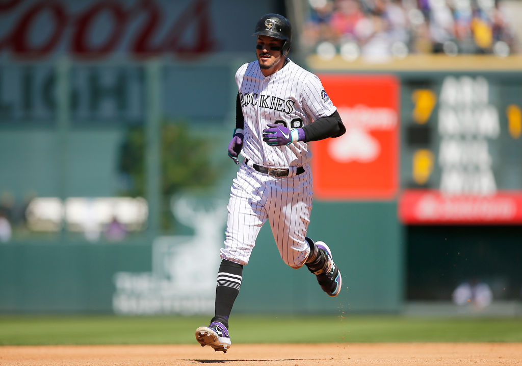 DENVER, CO - SEPTEMBER 12: Colorado Rockies Third base Nolan Arenado (28) rounds the bases following a homerun during a game between the Colorado Rockies and the visiting St. Louis Cardinals on September 12, 2019 at Coors Field in Denver, CO