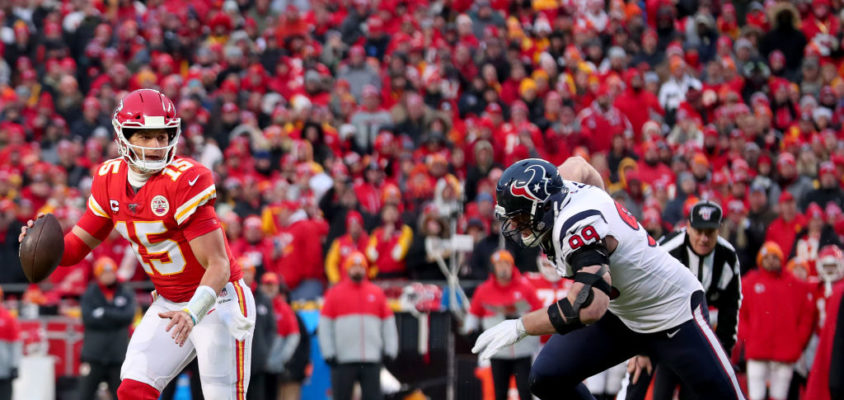 KANSAS CITY, MISSOURI - JANUARY 12: Patrick Mahomes #15 of the Kansas City Chiefs scrambles under pressure from J.J. Watt #99 of the Houston Texans on the second half of the AFC Divisional Round Playoff game at Arrowhead Stadium on January 12, 2020 in Kansas City, Missouri
