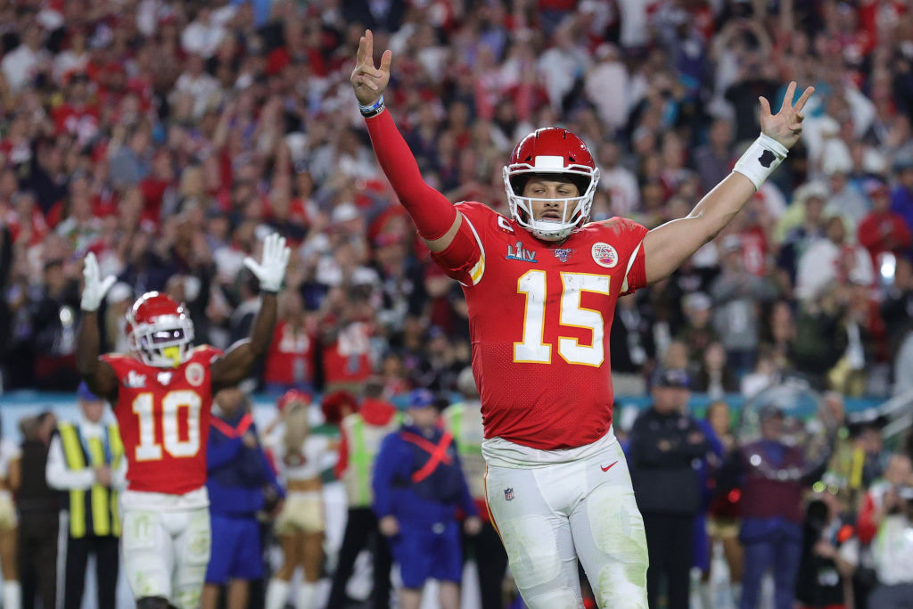 MIAMI, FLORIDA - FEBRUARY 02: Patrick Mahomes #15 of the Kansas City Chiefs celebrates after throwing a touchdown pass against the San Francisco 49ers during the fourth quarter in Super Bowl LIV at Hard Rock Stadium on February 02, 2020 in Miami, Florida.