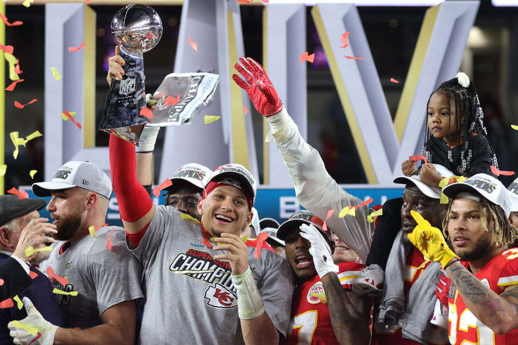 MIAMI, FLORIDA - FEBRUARY 02: Patrick Mahomes #15 of the Kansas City Chiefs raises the Vince Lombardi Trophy after defeating the San Francisco 49ers 31-20 in Super Bowl LIV at Hard Rock Stadium on February 02, 2020 in Miami, Florida.