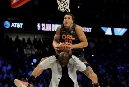 CHICAGO, ILLINOIS - FEBRUARY 15: Aaron Gordon #00 of the Orlando Magic dunks the ball over Tacko Fall of the Boston Celtics in the 2020 NBA All-Star - AT&T Slam Dunk Contest during State Farm All-Star Saturday Night at the United Center on February 15, 2020 in Chicago, Illinois