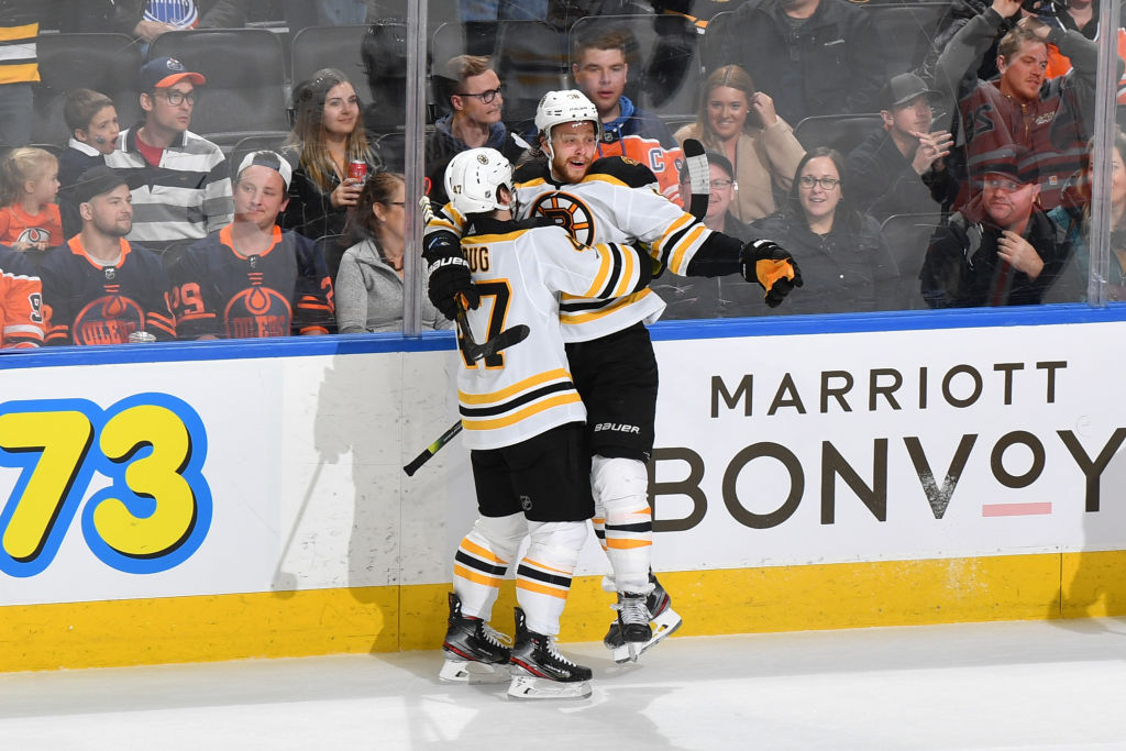 EDMONTON, AB - FEBRUARY 19: David Pastrnak #88 and Torey Krug #47 of the Boston Bruins celebrate after winning the game against the Edmonton Oilers on February 19, 2020, at Rogers Place in Edmonton, Alberta, Canada