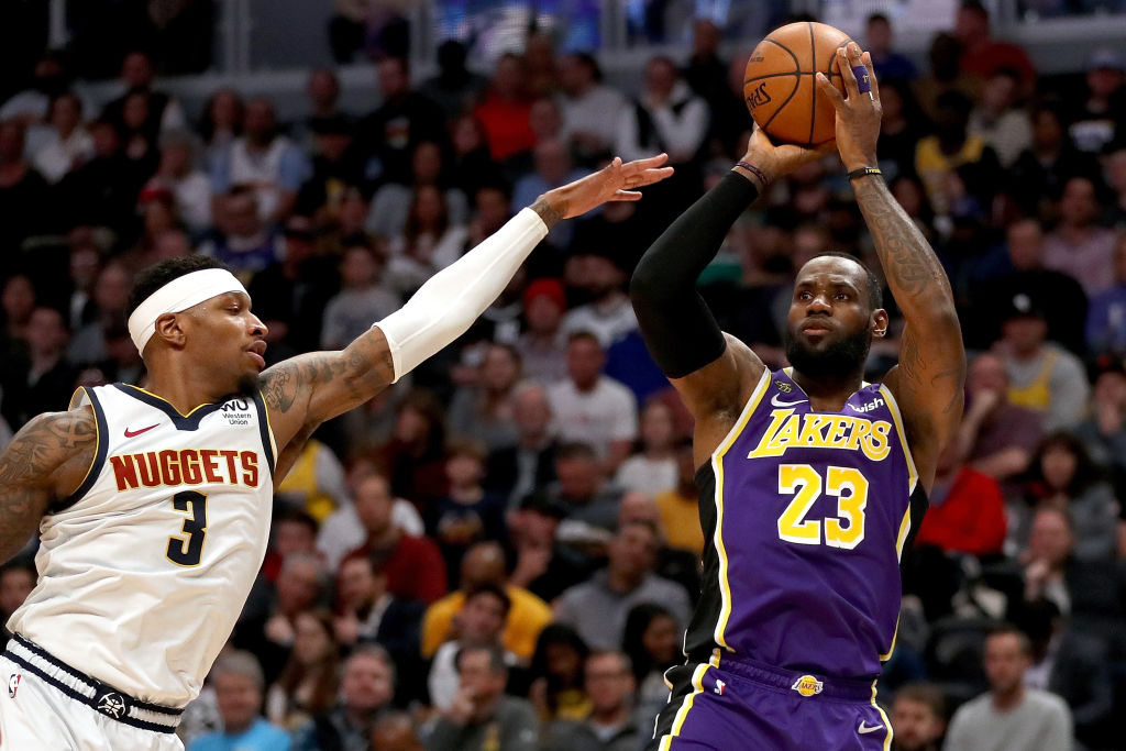 DENVER, COLORADO - FEBRUARY 12: LeBron James #23 of the Los Angeles Lakers puts up a shot against Torrey Craig #3 of the Denver Nuggets in the first quarter at Pepsi Center on February 12, 2020 in Denver, Colorado