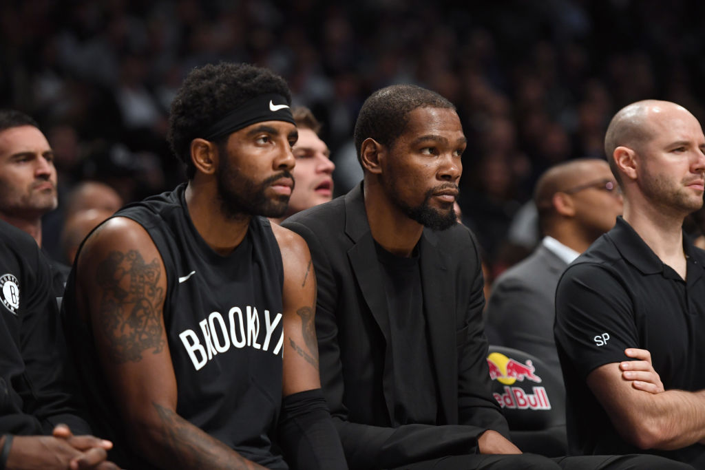 NEW YORK, NEW YORK - NOVEMBER 04: Kyrie Irving #11 and Kevin Durant #7 of the Brooklyn Nets react during the game against the New Orleans Pelicans at Barclays Center on November 04, 2019 in New York City