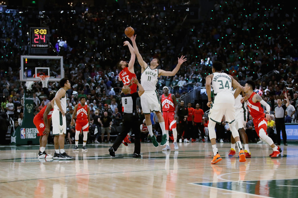MILWAUKEE, WISCONSIN - MAY 23: Marc Gasol #33 of the Toronto Raptors and Brook Lopez #11 of the Milwaukee Bucks jump for the tipoff in the first quarter during Game Five of the Eastern Conference Finals of the 2019 NBA Playoffs at the Fiserv Forum on May 23, 2019 in Milwaukee, Wisconsin