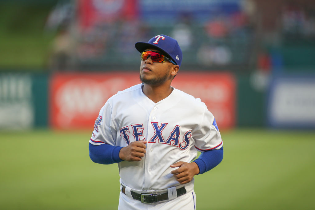 ARLINGTON, TX - SEPTEMBER 25: Texas Rangers outfielder Willie Calhoun (5) runs to the dugout during the game between the Boston Red Sox and Texas Rangers on September 25, 2019 at Globe Life Park in Arlington, TX