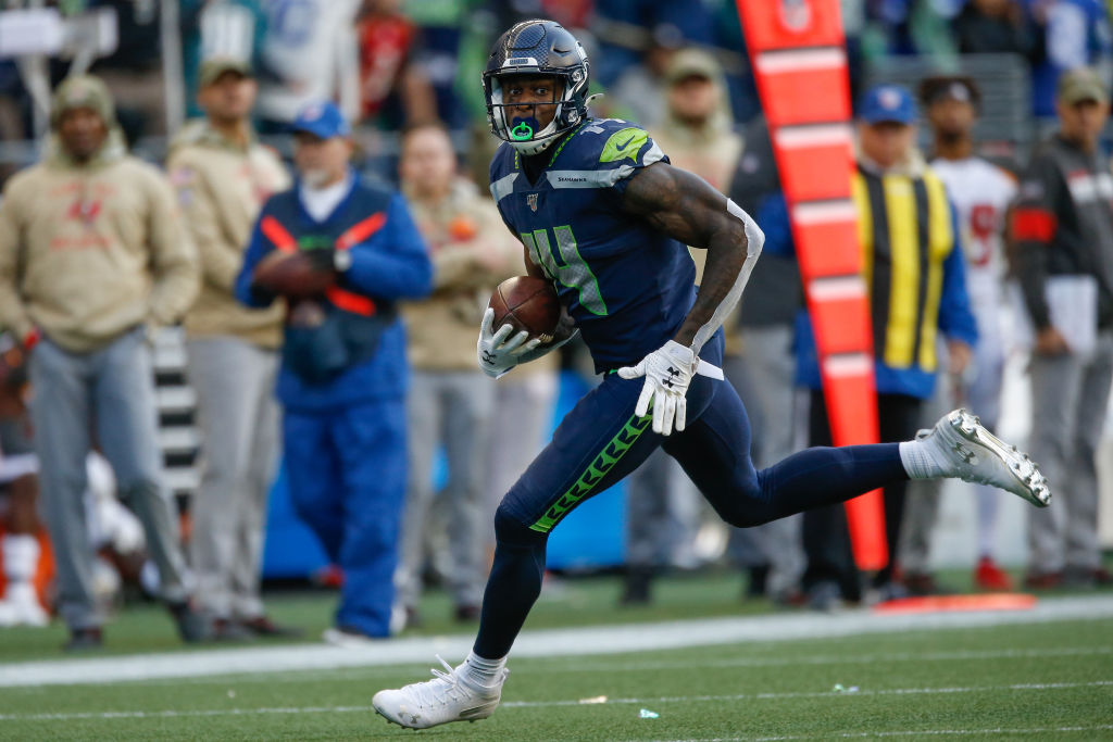 SEATTLE, WA - NOVEMBER 03: Wide receiver DK Metcalf #14 of the Seattle Seahawks rushes for a touchdown in the second half against the Tampa Bay Buccaneers at CenturyLink Field on November 3, 2019 in Seattle, Washington. The Seahawks beat the Buccaneers 40-34 in overtime