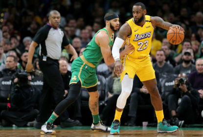 BOSTON, MASSACHUSETTS - JANUARY 20: Jayson Tatum #0 of the Boston Celtics defends LeBron James #23 of the Los Angeles Lakers at TD Garden on January 20, 2020 in Boston, Massachusetts. The Celtics defeat the Lakers 139-107