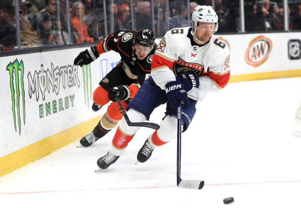 ANAHEIM, CALIFORNIA - FEBRUARY 19: Anton Stralman #6 of the Florida Panthers skates with the puck away from Rickard Rakell #67 of the Anaheim Ducks during the first period of a game at Honda Center on February 19, 2020 in Anaheim, California