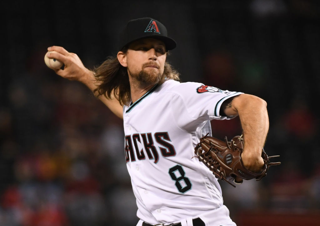 PHOENIX, ARIZONA - SEPTEMBER 24: Mike Leake #8 of the Arizona Diamondbacks delivers a first inning pitch against the St Louis Cardinals at Chase Field on September 24, 2019 in Phoenix, Arizona