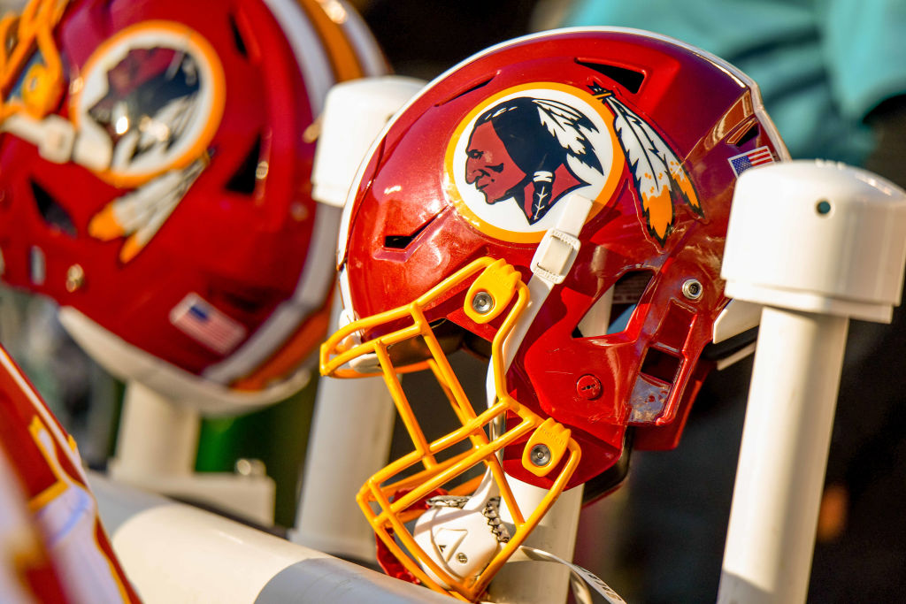CHARLOTTE, NC - DECEMBER 01: A Washington Redskins helmet rest on the warmer behind the bench during the game between the Carolina Panthers and the Washington Redskins at Bank of America Stadium on December 01, 2019 in Charlotte, NC