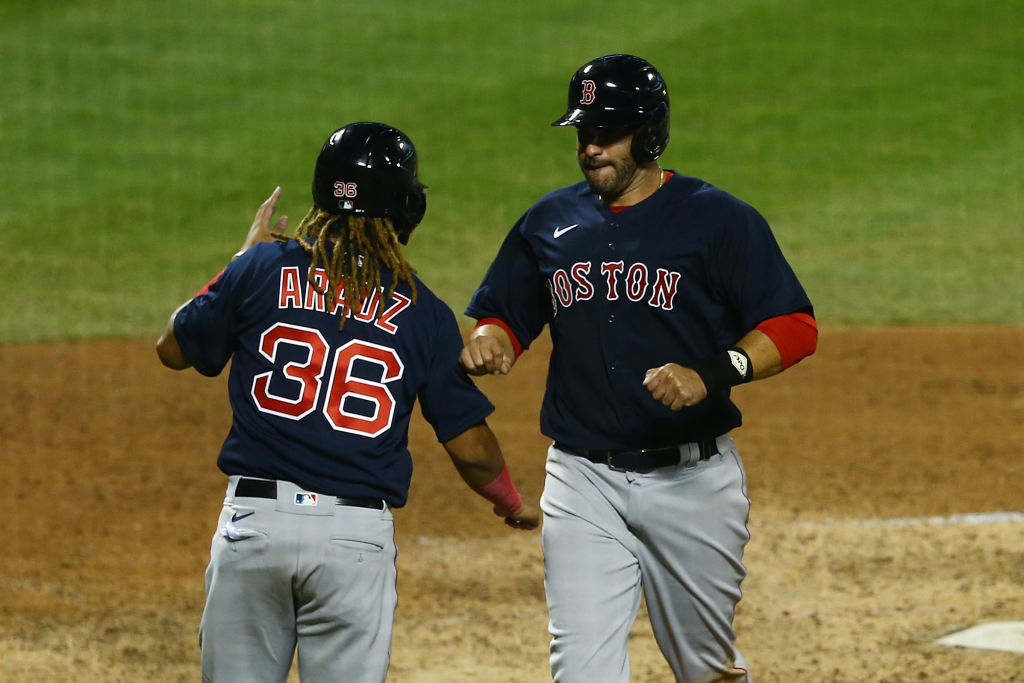 NEW YORK, NEW YORK - JULY 29: J.D. Martinez #28 and Jonathan Arauz #36 of the Boston Red Sox celebrate after scoring on Christian Vazquez #7 single in the eighth inning against the New York Mets at Citi Field on July 29, 2020 in New York City