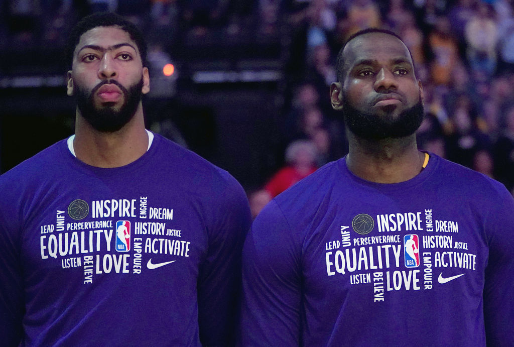 SACRAMENTO, CALIFORNIA - FEBRUARY 01: LeBron James #23 (R) and Anthony Davis #3 of the Los Angeles Lakers (L) stands for the National Anthem prior to the start of an NBA basketball game against the Sacramento Kings at Golden 1 Center on February 01, 2020 in Sacramento, California
