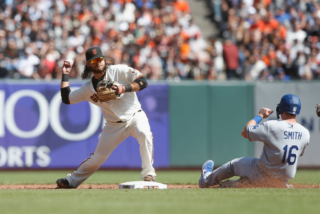SAN FRANCISCO, CALIFORNIA - SEPTEMBER 29: Brandon Crawford #35 of the San Francisco Giants gets the out at second base of Will Smith #16 of the Los Angeles Dodgers in the top of the third inning at Oracle Park on September 29, 2019 in San Francisco, California