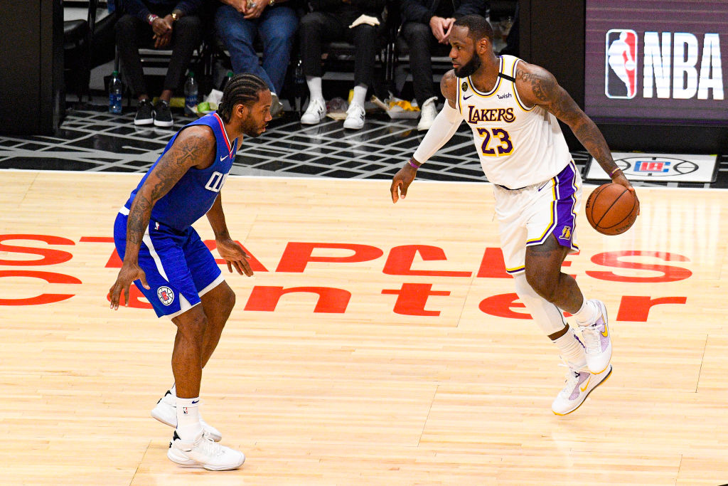 LOS ANGELES, CA - MARCH 08: Los Angeles Lakers Forward LeBron James (23) guarded by Los Angeles Clippers Forward Kawhi Leonard (2) during a NBA game between the Los Angeles Lakers and the Los Angeles Clippers on March 8, 2020 at STAPLES Center in Los Angeles, CA