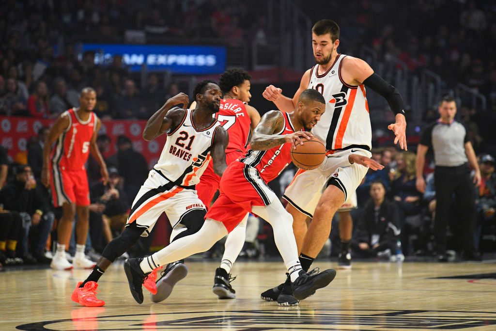LOS ANGELES, CA - NOVEMBER 07: Portland Trail Blazers Guard Damian Lillard (0) tries to dribble past Los Angeles Clippers Guard Patrick Beverley (21) and Los Angeles Clippers Center Ivica Zubac (40) during a NBA game between the Portland Trailblazers and the Los Angeles Clippers on November 7, 2019 at STAPLES Center in Los Angeles, CA.