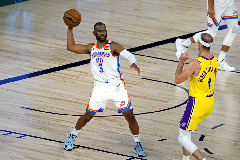 LAKE BUENA VISTA, FLORIDA - AUGUST 05: Chris Paul #3 of the Oklahoma City Thunder handles the ball on offense against the Los Angeles Lakers during the first quarter at HP Field House at ESPN Wide World Of Sports Complex on August 05, 2020 in Lake Buena Vista, Florida