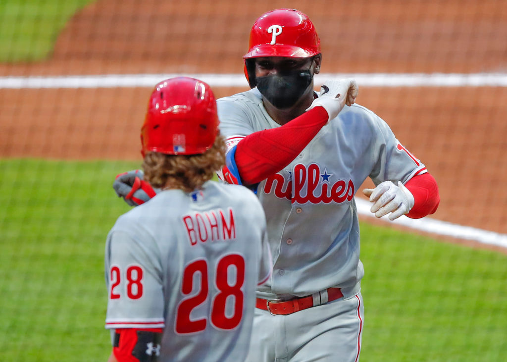 ATLANTA, GA - AUGUST 23: Didi Gregorius #18 of the Philadelphia Phillies celebrates a home run with Alec Bohm #28 in the third inning of an MLB game against the Atlanta Braves at Truist Park on August 23, 2020 in Atlanta, Georgia