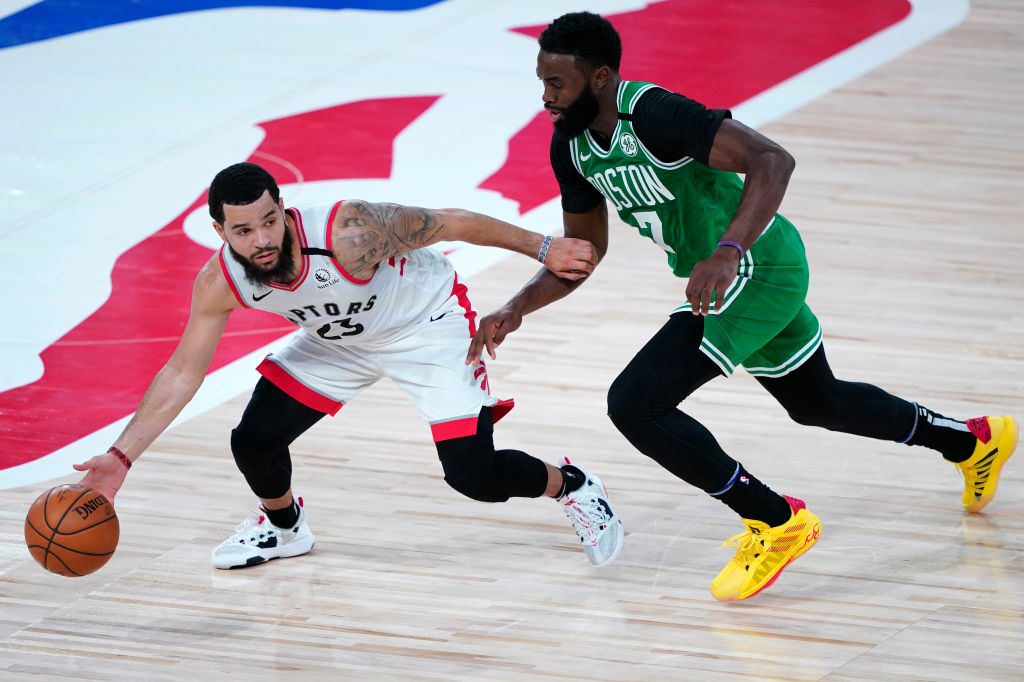 LAKE BUENA VISTA, FLORIDA - AUGUST 07: Fred VanVleet #23 of the Toronto Raptors, left, works against Jaylen Brown #7 of the Boston Celtics during the first half of an NBA basketball game at the ESPN Wide World Of Sports Complex on August 7, 2020 in Lake Buena Vista, Florida
