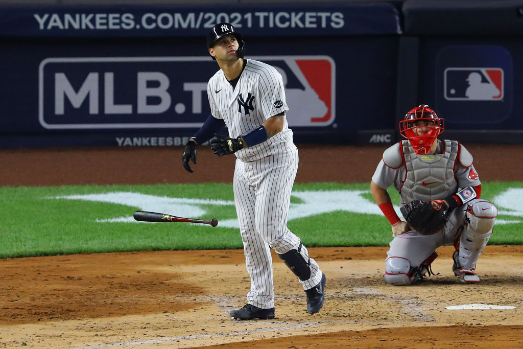 NEW YORK, NEW YORK - AUGUST 15: Gary Sanchez #24 of the New York Yankees hits a 2-run home run in the fourth inning against the Boston Red Sox at Yankee Stadium on August 15, 2020 in New York City