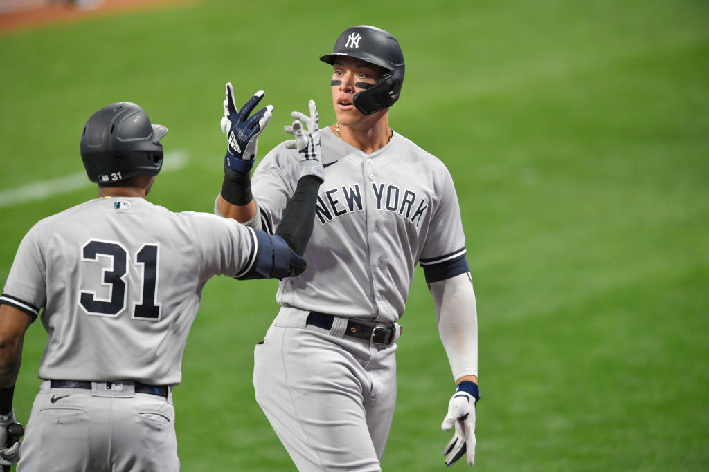 CLEVELAND, OHIO - SEPTEMBER 29: Aaron Hicks #31 celebrates with Aaron Judge #99 of the New York Yankees after Judge hit a two run homer during the first inning of Game One of the American League Wild Card Series against the Cleveland Indians at Progressive Field on September 29, 2020 in Cleveland, Ohio